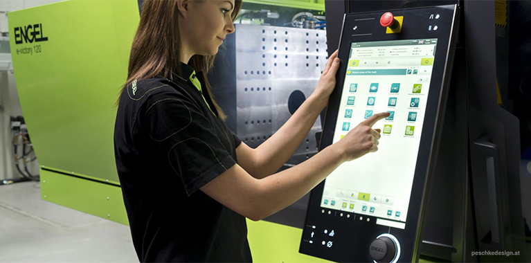A user is working with the engel hmi.