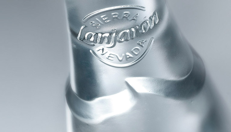 Design detail of a glass bottle for restaurants and catering.