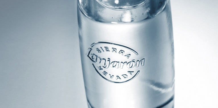 Detail of a multi-use refillable glass bottle.