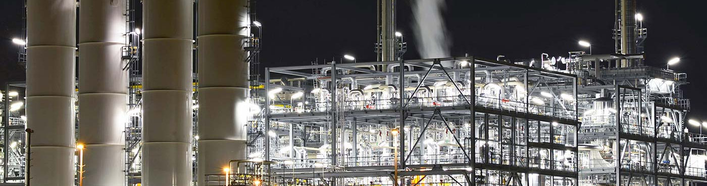 Petroleum refinery at night.